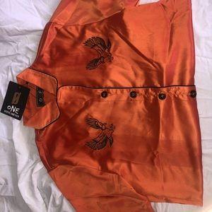 Orange silk button up with tiny black design